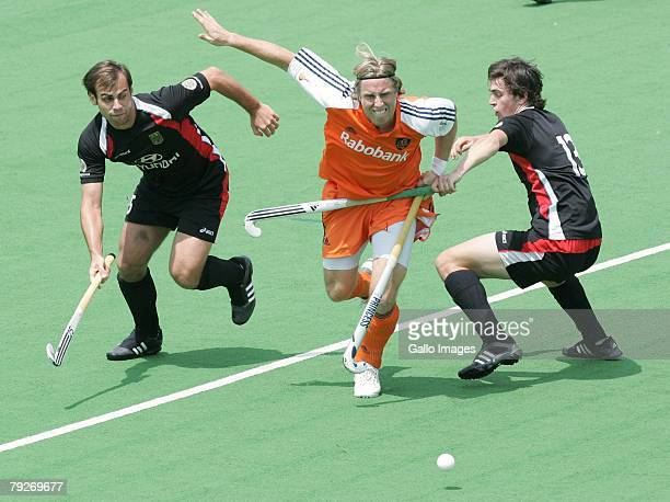 Roderick Wuesthof of Netherlands is challenged by Sebastian Biederlack and Tobias Hauke during the Five Nations Mens Hockey tournament match between...