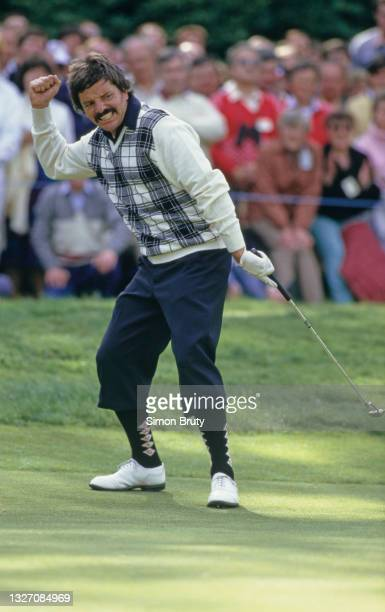 Rodger Davis of Australia punches the air in celebration after holing a putt during the Whyte & Mackay PGA Championship on 22nd May 1987 at The...