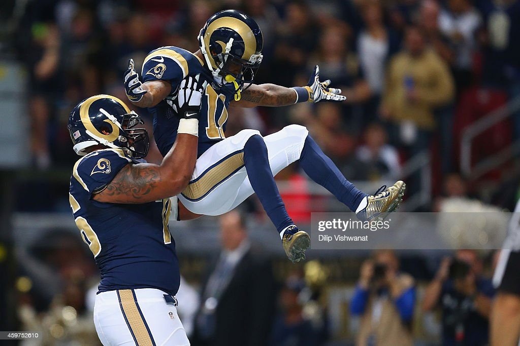 Rodger Saffold #76 and Tavon Austin #11 of the St. Louis Rams celebrate Austin's first quarter touchdown against the Oakland Raiders at the Edward Jones Dome on November 30, 2014 in St. Louis, Missouri.