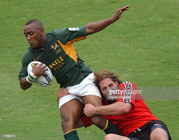 Rodger Smith of South Africa is tackled by Marco DiGirolamo of Canada during the Canada and South Africa match during the Brisbane World Rugby Sevens...