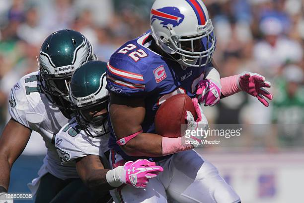 D RodgersCromartie and Jarrad Page of the Philadelphia Eagles tackle running back Freddie Jackson of the Buffalo Bills during the second half at...