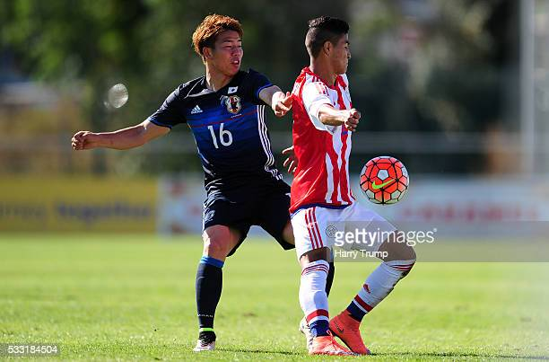 Rodi Ferreira of Paraguay is tackled by Takuma Asano of Japan during the Toulon Tournament match between Japan and Paraguay at Stade De Lattre on May...