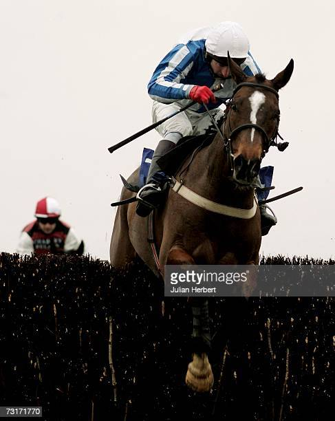 Rodi Green and Wizard Of Edge clear the second last fence to land The CPM Group Handicap Steeple Chase Race run at Wincanton Racecourse on February 1...