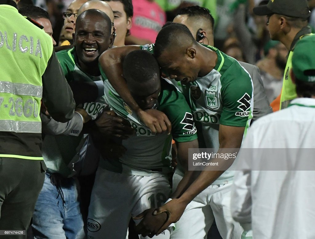 Rodin Quiñones (C) of Nacional celebrates with teammate Edwin Velasco (R) after scoring the fifth goal of his team during the Final second leg match between Atletico Nacional and Deportivo Cali as part of Liga Aguila I 2017 at Atanasio Girardot Stadium on June 18, 2017 in Medellin, Colombia.