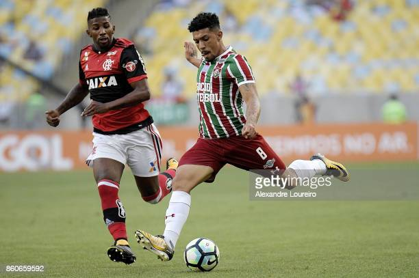 Rodinei of Flamengo battles for the ball with Douglas of Fluminense during the match between Flamengo and Fluminense as part of Brasileirao Series A...