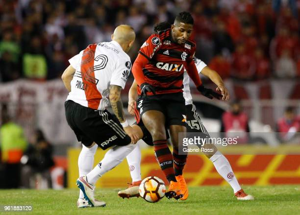 Rodinei of Flamengo fights for the ball with Javier Pinola of River Plate during a match between River Plate and Flamengo as part of Copa CONMEBOL...