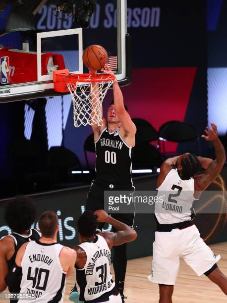 Rodions Kurucs of the Brooklyn Nets dunks over Kawhi Leonard of the LA Clippers in the second half of a NBA basketball game at AdventHealth Arena at...