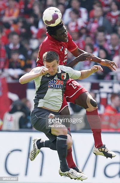 Rodnei of Kaiserslautern outjumps Daniel Baier of Augsburg during the Second Bundesliga match between 1 FC Kaiserslautern and FC Augsburg at the...