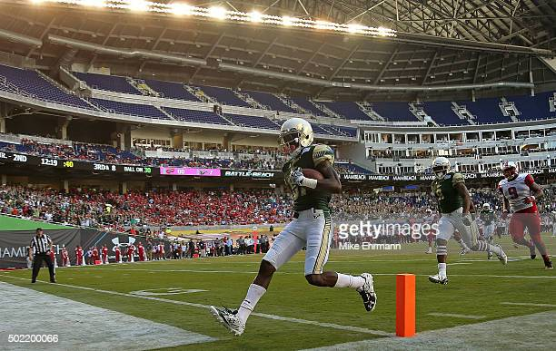 Rodney Adams of the South Florida Bulls rushes for a touchdown during the 2015 Miami Beach Bowl against the Western Kentucky Hilltoppers at Marlins...