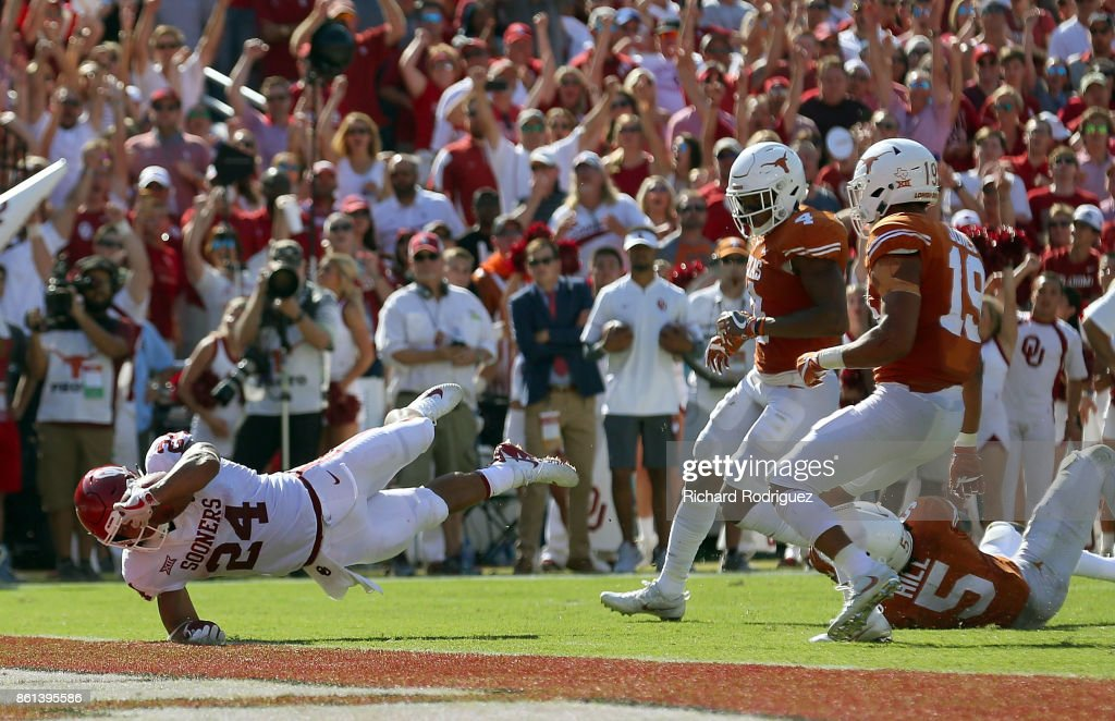 Rodney Anderson #24 of the Oklahoma Sooners leaps toward the goal line for a touchdown in the second quarter against the Texas Longhorns at Cotton Bowl on October 14, 2017 in Dallas, Texas.