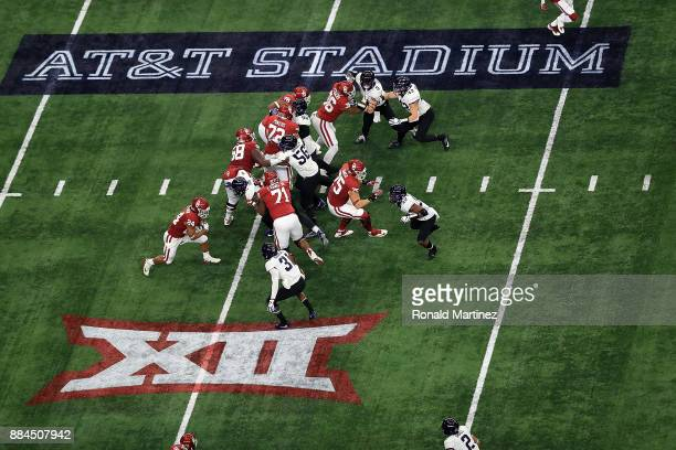 Rodney Anderson of the Oklahoma Sooners runs the ball against the TCU Horned Frogs in the first quarter during Big 12 Championship at ATT Stadium on...