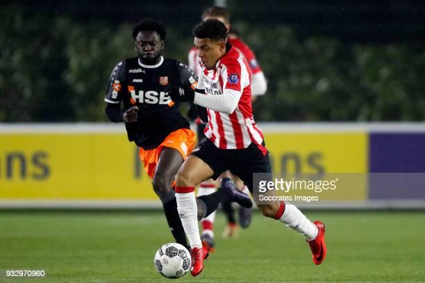Rodney Antwi of FC Volendam Donyell Malen of PSV U23 during the Dutch Jupiler League match between PSV U23 v FC Volendam at the De Herdgang on March...