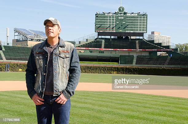 Rodney Atkins stands on the pitcher's mound during the Rodney Atkins TAKE A BACK ROAD album release at Wrigley Field on October 4, 2011 in Chicago,...