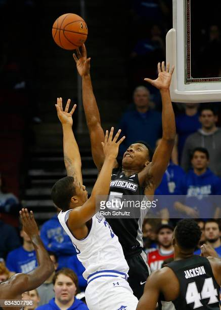 Rodney Bullock of the Providence Friars blocks a shot by Desi Rodriguez of the Seton Hall Pirates during the first half of an NCAA college basketball...