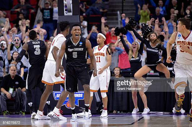Rodney Bullock of the Providence Friars celebrates after hitting a basket late in the second half against the USC Trojans during the first round of...