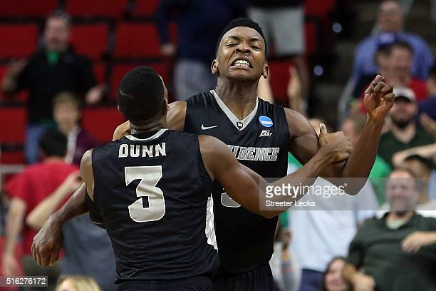 Rodney Bullock of the Providence Friars celebrates with teammate Kris Dunn after scoring the game winning points to defeat the USC Trojans with a...