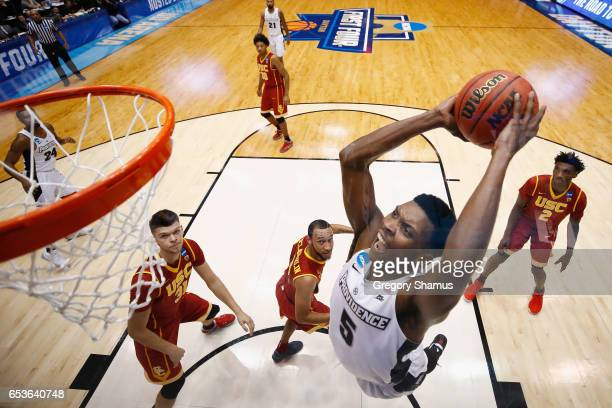 Rodney Bullock of the Providence Friars dunks the ball in the first half against the USC Trojans during the First Four game in the 2017 NCAA Men's...