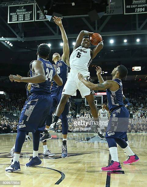 Rodney Bullock of the Providence Friars grabs a rebound from the defense of the Georgetown Hoyas in the first half on February 13 at the Dunkin'...