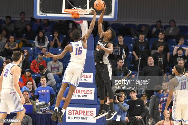 Rodney Bullock of the Providence Friars takes a shot over Paul Reed of the DePaul Blue Demons during a college basketball game at Wintrust Arena on...