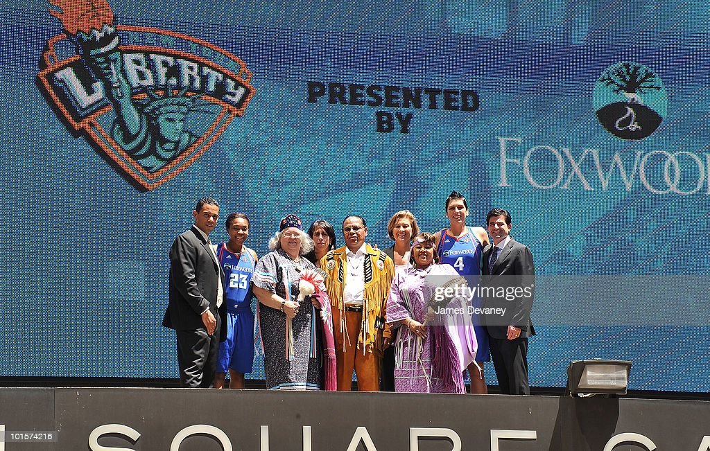 Rodney Butler, Cappie Poindexter, Joyce Walker, Donna Orender, Anthony Sebastian, Carol Blazejowski, Priscilla Brown, Janel McCarville and Scott O'Neil pose for photos atop the Madison Square Garden marquee to promote new partnership between NY Liberty and Foxwoods at Madison Square Garden on June 2, 2010 in New York City.