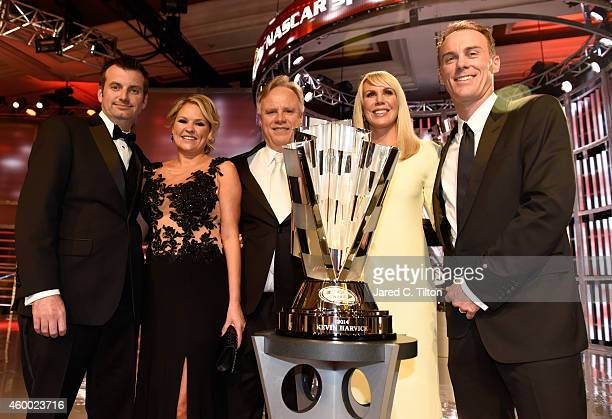 Rodney Childers, Katrina Childers, Gene Haas, DeLana Harvick and Kevin Harvick pose with the championship trophy during the 2014 NASCAR Sprint Cup...