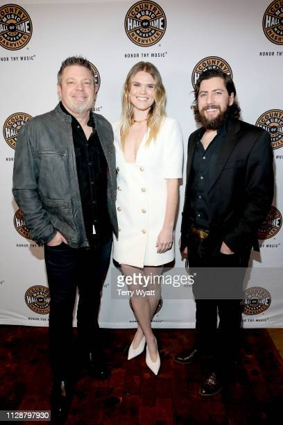 Rodney Clawson Nicolle Galyon and Brad Clawson attend the Country Music Hall of Fame and Museum's new exhibition American Currents The Music of 2018...