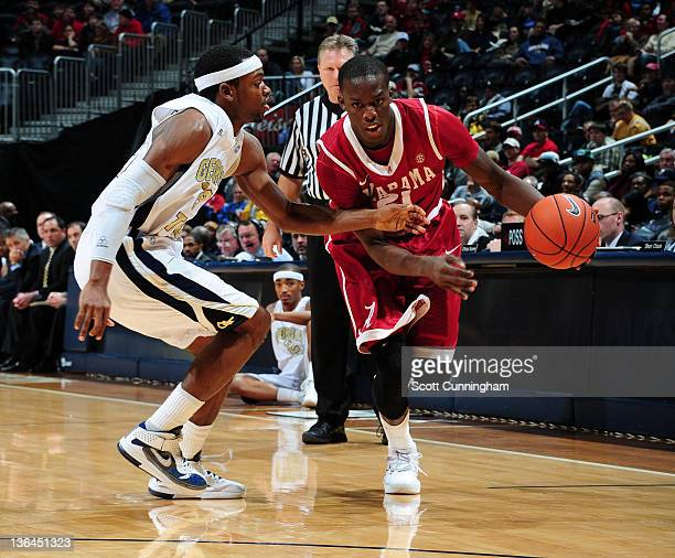 Rodney Cooper of the Alabama Crimson Tide drives against Brandon Reed of the Georgia Tech Yellow Jackets at Philips Arena on January 3 2012 in...