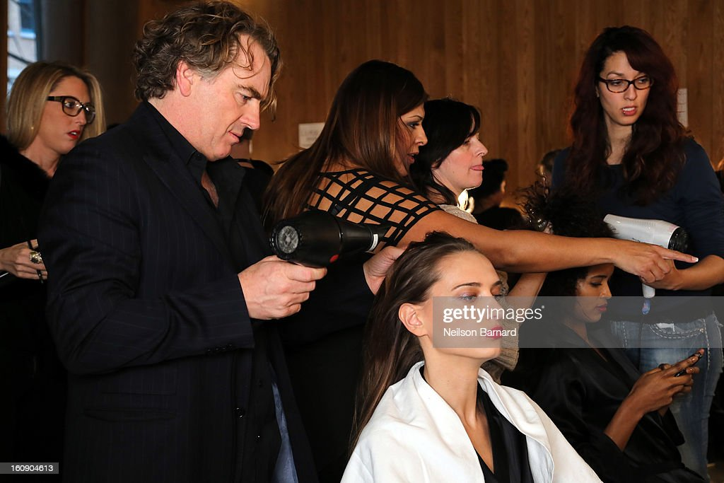 Rodney Cutler, Redken Expert And Celebrity Runway Stylist For THE SALON At Ulta Beauty Backstage prepares model's hair at the La Perla Fall 2013 Presentation on February 7, 2013 in New York City.