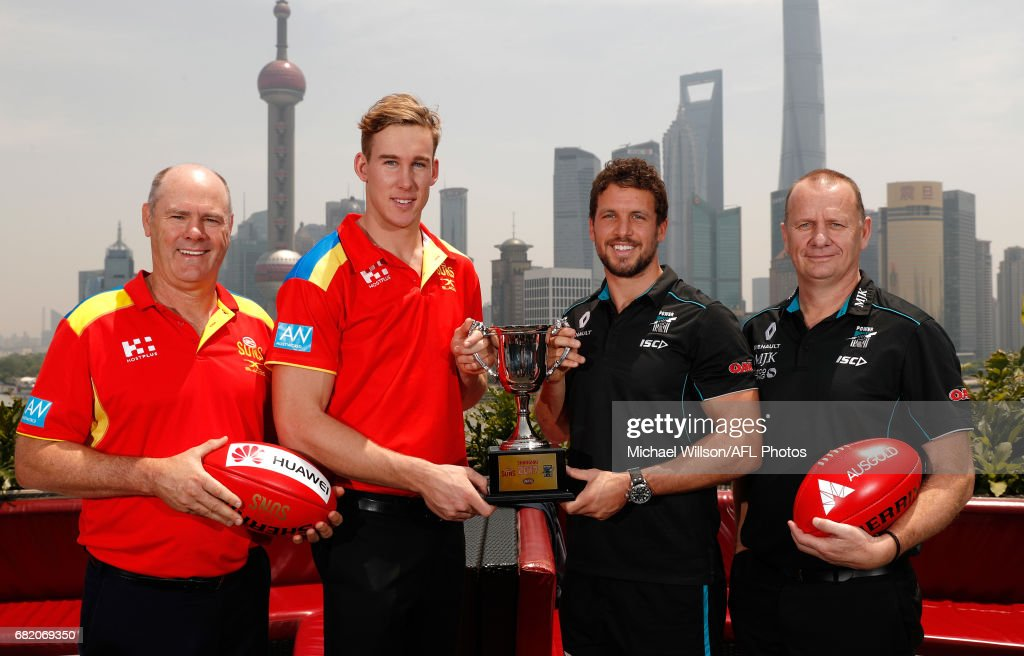 Rodney Eade, Senior Coach of the Suns, Tom Lynch of the Suns, Travis Boak of the Power and Ken Hinkley, Senior Coach of the Power pose for a photograph with the 2017 Shanghai Cup during the Port Adelaide Power and Gold Coast Suns joint Captain and Coach press conference at Bar Rouge overlooking The Bund on May 11, 2017 in Shanghai, China.