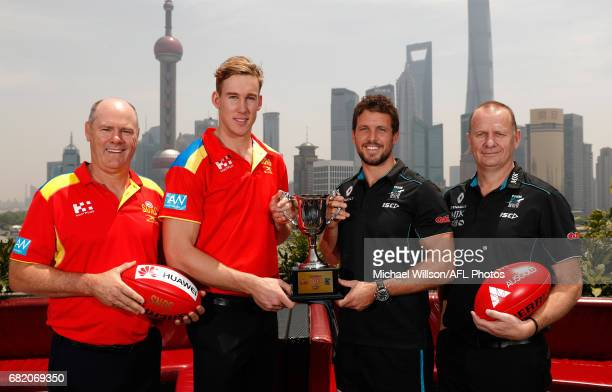 Rodney Eade Senior Coach of the Suns Tom Lynch of the Suns Travis Boak of the Power and Ken Hinkley Senior Coach of the Power pose for a photograph...