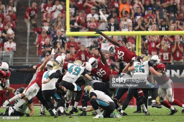 Rodney Gunter and Chandler Jones of the Arizona Cardinals attempt to block Josh Lambo of the Jacksonville Jaguars field goal kick in the first half...