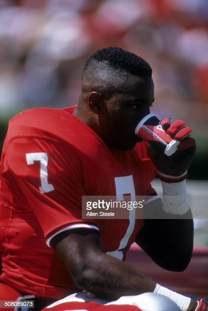 Rodney Hampton of the Georgia Bulldogs has a drink from the bench during the game against the Baylor Bears on September 16 1989 at Sanford Stadium in...
