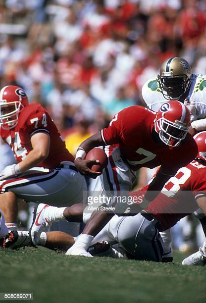 Rodney Hampton of the Georgia Bulldogs runs with the ball during the game against the Baylor Bears on September 16 1989 at Sanford Stadium in Athens...