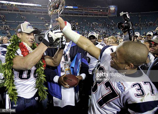 Rodney Harrison and Christian Fauria of the New England Patriots celebrate with the Lombardi Trophy after defeating the Philadelphia Eagles in Super...