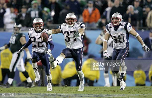 Rodney Harrison Asante Samuel and Mike Vrabel of the New England Patriots celebrate after defeating the Philadelphia Eagles in Super Bowl XXXIX at...