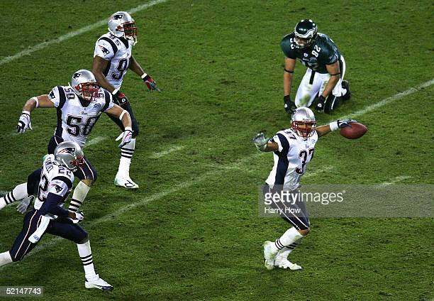 Rodney Harrison Asante Samuel and Mike Vrabel of the New England Patriots celebrate after defeating tight end LJ Smith and the Philadelphia Eagles in...