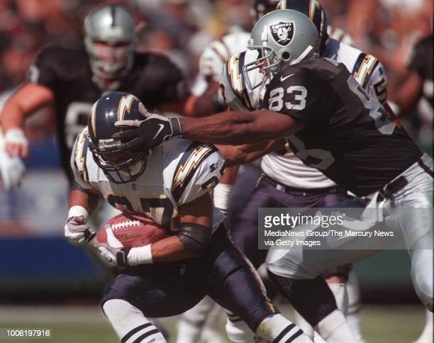S Rodney Harrison comes up with an interception as Raiders Rickey Dudley tries to make the play during the first quarter