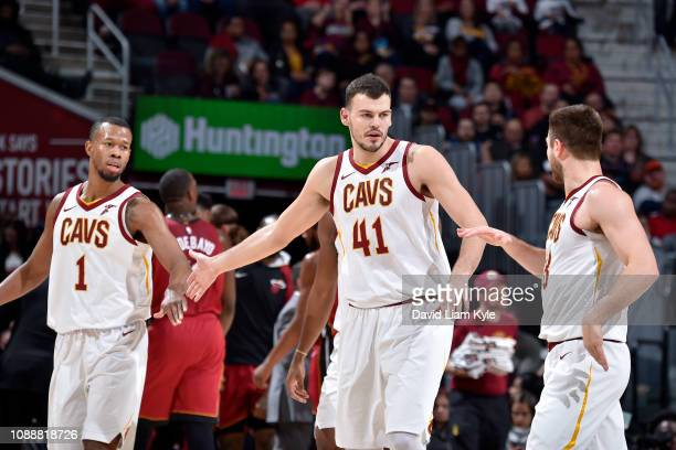 Rodney Hood and Ante Zizic of the Cleveland Cavaliers highfive during a game against the Miami Heat on January 25 2019 at Quicken Loans Arena in...