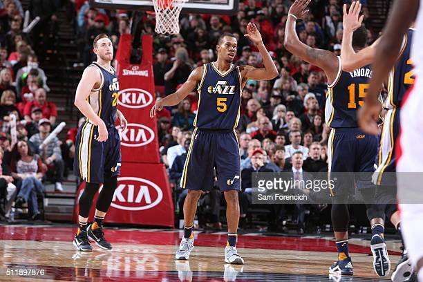 Rodney Hood and Derrick Favors of the Utah Jazz celebrate against the Portland Trail Blazers on February 21 2016 at the Moda Center Arena in Portland...