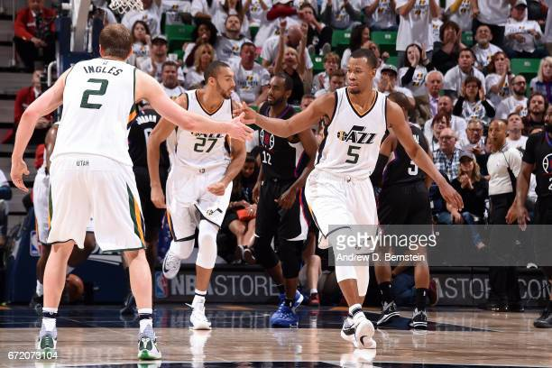 Rodney Hood and Joe Ingles of the Utah Jazz high five each other during the game against the LA Clippers in Game Four during the Western Conference...