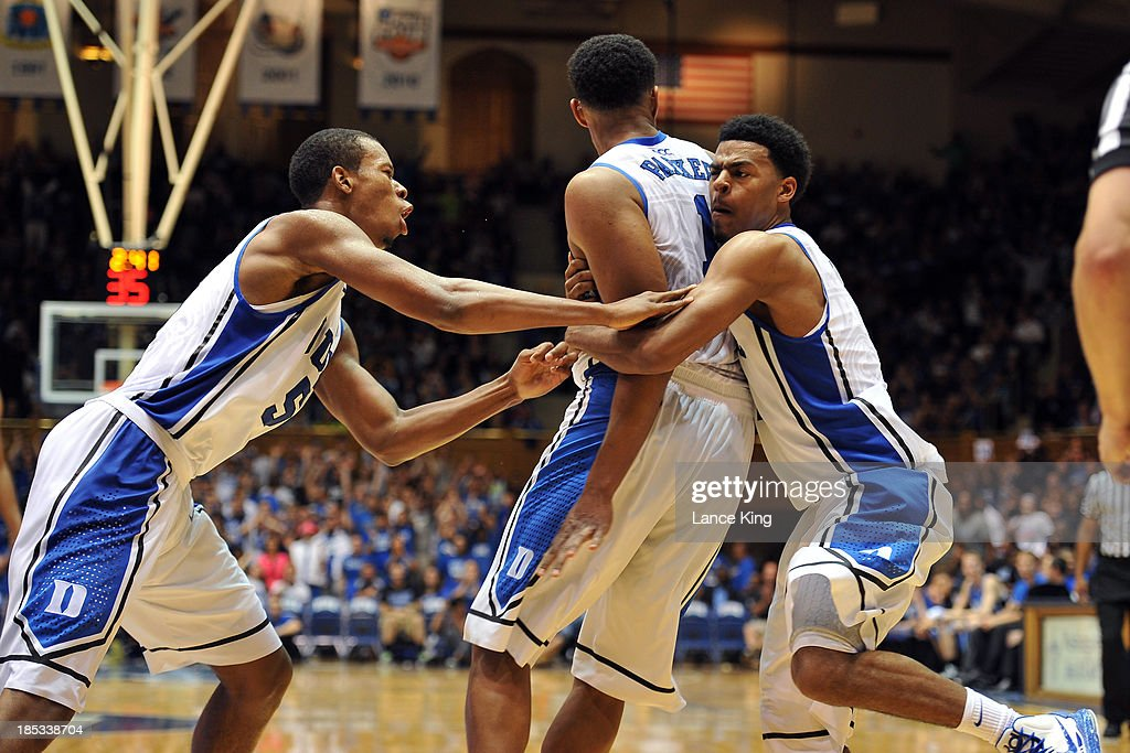 Rodney Hood #5 and Quinn Cook #2 celebrate with Jabari Parker #1 of the Duke Blue Devils following a dunk by Parker during Countdown to Craziness at Cameron Indoor Stadium on October 18, 2013 in Durham, North Carolina.