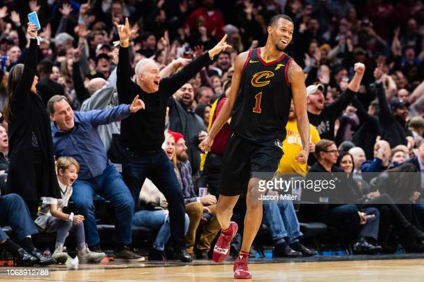 Rodney Hood of the Cleveland Cavaliers and the fans celebrate after Hood hit a buzzer beater at the end of the first half against the Golden State...