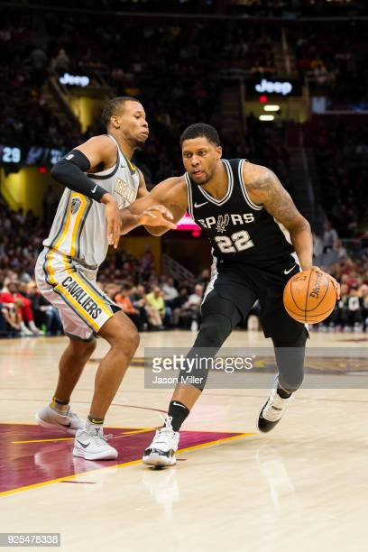 Rodney Hood of the Cleveland Cavaliers guards Rudy Gay of the San Antonio Spurs during the second half at Quicken Loans Arena on February 25 2018 in...