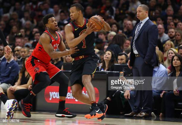 Rodney Hood of the Cleveland Cavaliers is defended by Kyle Lowry of the Toronto Raptors during the first half of Game Three of the Eastern Conference...