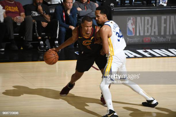 Rodney Hood of the Cleveland Cavaliers moves the ball against Shaun Livingston of the Golden State Warriors during Game Three of the 2018 NBA Finals...