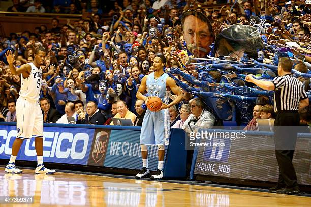 Rodney Hood of the Duke Blue Devils watches as J.P. Tokoto of the North Carolina Tar Heels throws the ball in during their game at Cameron Indoor...