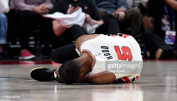 Rodney Hood of the Portland Trail Blazers lays on the court after being injured during the first half of the game against the Los Angeles Lakers at...
