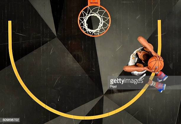 Rodney Hood of the Utah Jazz and the United States team goes up for a dunk in the first half against the World team during the BBVA Compass Rising...