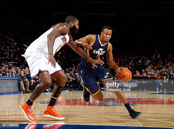 Rodney Hood of the Utah Jazz drives against Kyle O'Quinn of the New York Knicks during a game between the Utah Jazz and the New York Knicks at...