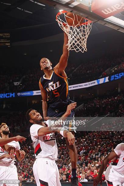 Rodney Hood of the Utah Jazz dunks the ball during a game against the Portland Trail Blazers on October 25 2016 at the Moda Center Arena in Portland...
